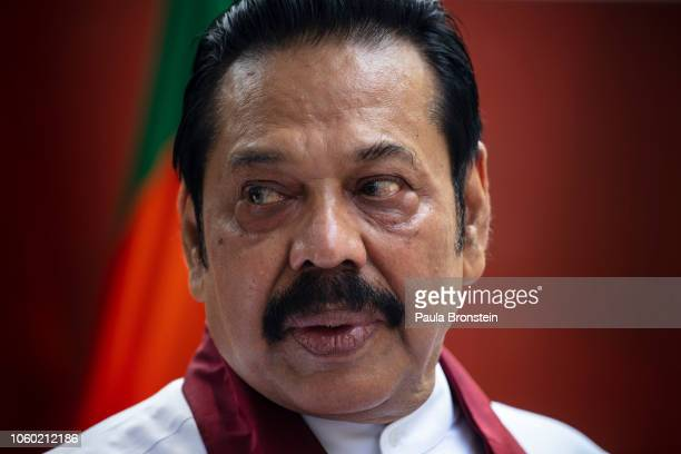 Acting Prime Minister Mahinda Rajapaksa speaks to members of his party and the media as he formally joins the Sri Lanka Freedom party as the...