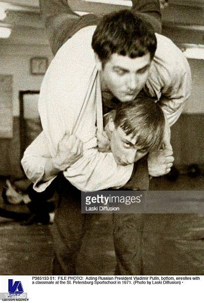 Acting Russian President Vladimir Putin, bottom, wrestles with a classmate at the St. Petersburg Sportschool in 1971.