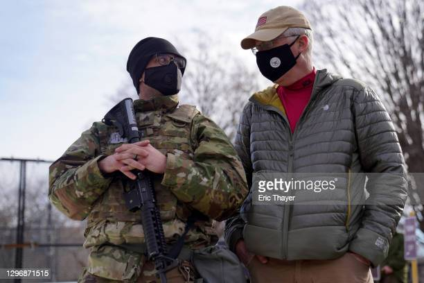 Acting Secretary of Defense Christopher Miller speaks with a member of the National Guard outside the U.S. Capitol on January 17, 2021 in Washington,...