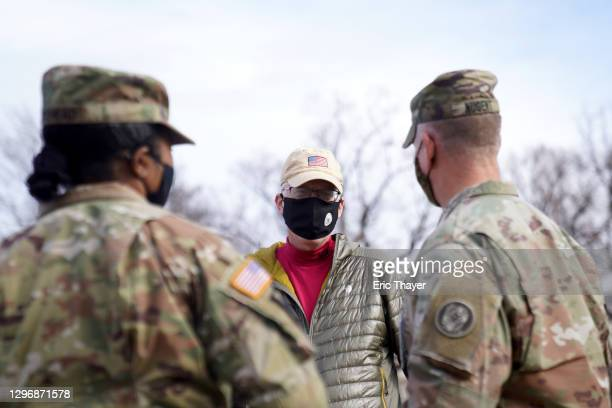 Acting Secretary of Defense Christopher Miller speaks with members of the National Guard outside the U.S. Capitol on January 17, 2021 in Washington,...