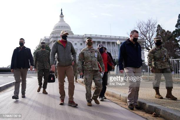 Acting Secretary of Defense Christopher Miller walks with members of the National Guard outside the U.S. Capitol on January 17, 2021 in Washington,...