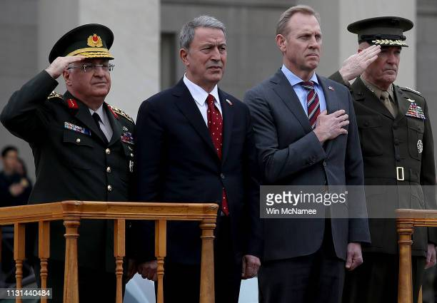 Acting Secretary of Defense Patrick Shanahan welcomes Turkish Minister of Defense Hulusi Akar to the Pentagon during an arrival ceremony February 22,...