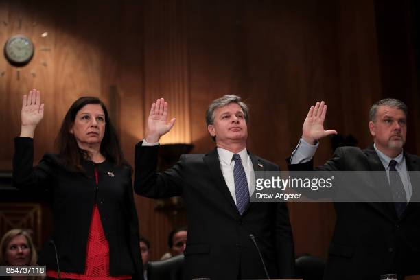 Acting Secretary of Homeland Security Elaine Duke Director of the Federal Bureau of Investigation Christopher Wray and Director of National...