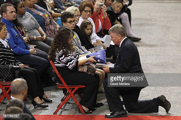 Acting Secretary of the US Department of Homeland Security Rand Beers presents a US flag to Ana Hernandez widow Transportation Security...