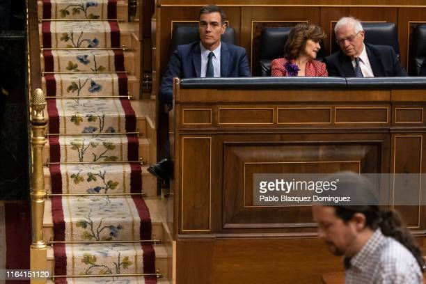 Acting Spanish Prime Minister Pedro Sanchez looks at Podemos party leader Pablo Iglesias past by during the third day of the investiture debate at...