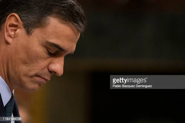 Acting Spanish Prime Minister Pedro Sanchez looks downs as he speaks during the third day of the investiture debate at the Spanish Parliament on July...