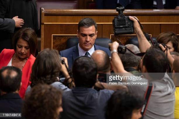 Acting Spanish Prime Minister Pedro Sanchez sits at his desk during the beginning of the third day of the investiture debate at the Spanish...