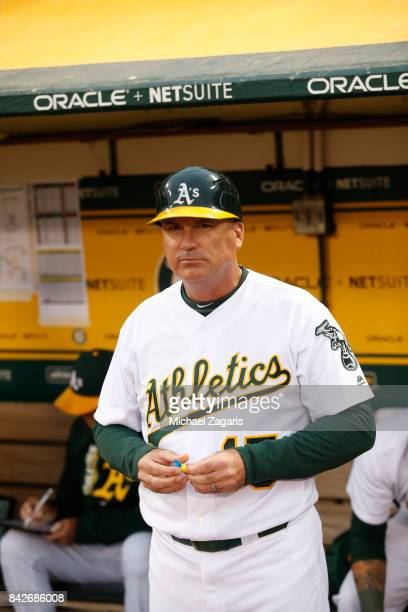 Acting Third Base Coach Steve Scarsone of the Oakland Athletics stands in the dugout during the game against the Kansas City Royals at the Oakland...