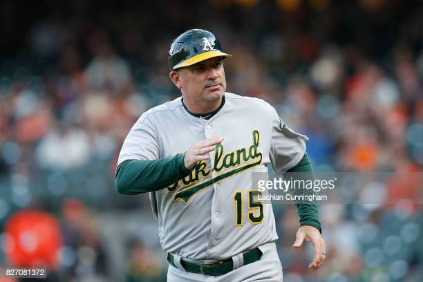 Acting third base coach Steve Scarsone of the Oakland Athletics looks on during an interleague game against the San Francisco Giants at ATT Park on...