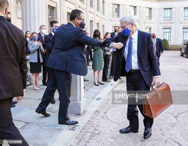 Acting U.S. Attorney General Monty Wilkinson greets newly confirmed U.S. Attorney General Merrick Garland as he arrives for his first day at the...
