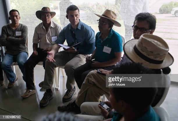 Acting US Homeland Security Secretary Kevin McAleenan meets with Guatemalan farmers on May 29 2019 in Santa Rosa Guatemala McAleenan is on a fourday...