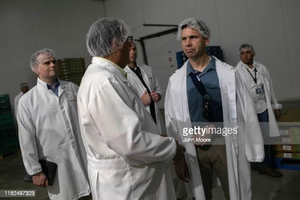 Acting US Homeland Security Secretary Kevin McAleenan visits a US AIDaffiliated vegetable packing facility on May 29 2019 in Santa Rosa Guatemala...