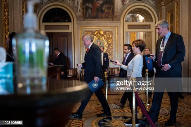 Acting White House Chief of Staff Mark Meadows walks to a meeting as negotiations on a COVID19 economic bailout continue on Capitol Hill March 24 in...