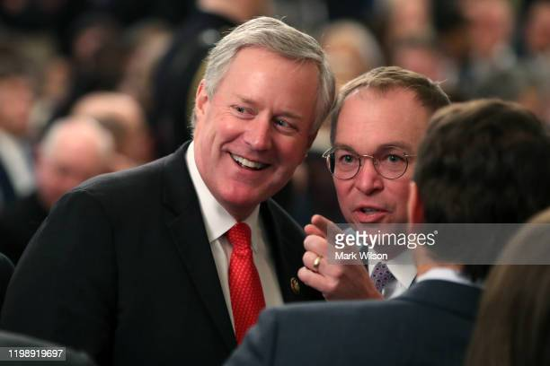 Acting White House Chief of Staff Mick Mulvaney and Rep Mark Meadows talk as they wait for US President Donald Trump to speak to the media one day...