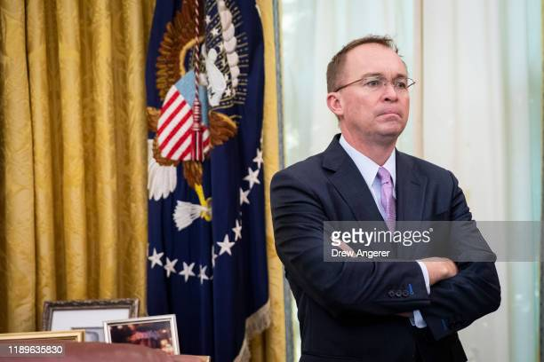 Acting White House Chief of Staff Mick Mulvaney look on as US Representative Jeff Van Drew of New Jersey who has announced he is switching from the...