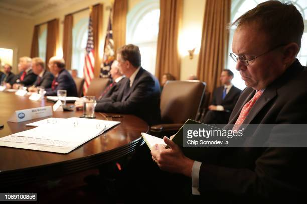 Acting White House Chief of Staff Mick Mulvaney takes notes as US President Donald Trump leads a meeting of his Cabinet in the Cabinet Room at the...