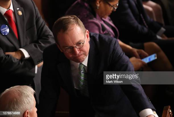 Acting White House Chief of Staff Mick Mulvaney talks to members of Congress prior to the first session of the 116th Congress at the US Capitol...
