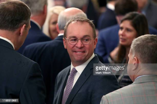 Acting White House Chief of Staff Mick Mulvaney waits for US President Donald Trump to speak to the media one day after the US Senate acquitted on...