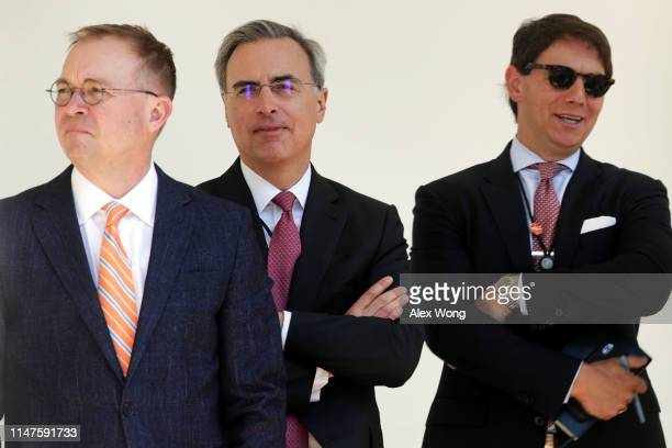 Acting White House Chief of Staff Mick Mulvaney White House Counsel Pat Cipollone and Principal Deputy Press Secretary Hogan Gidley listen during a...