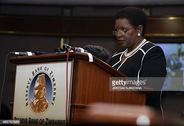 Acting Zimbabwe central bank governor Charity Dhliway addresses a conference in Harare on January 29 2014Zimbabwe on Wednesday approved domestic...