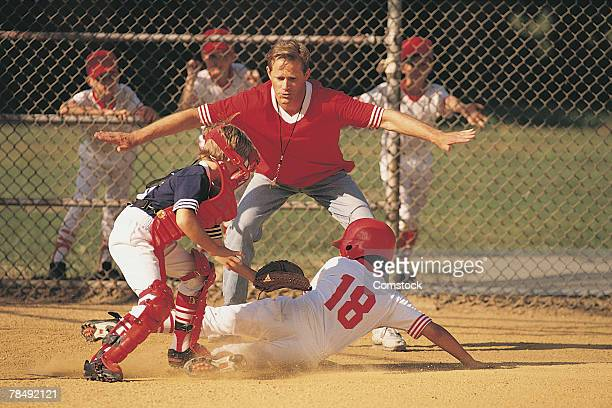 action at home plate in boys baseball game - home base sports stock pictures, royalty-free photos & images