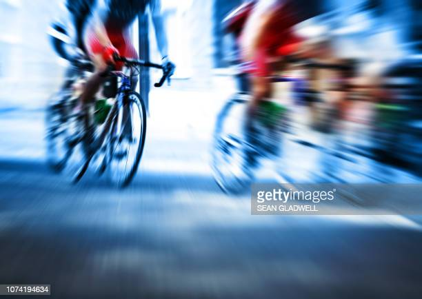 action blur cycle race - road race stock pictures, royalty-free photos & images