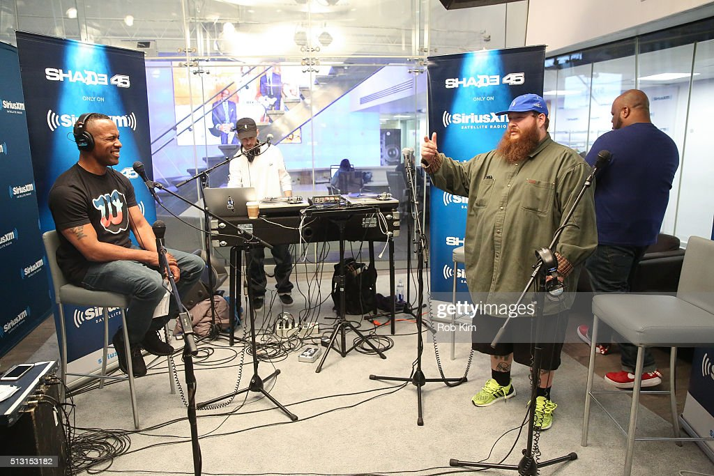 Action Bronson (R) talks with DJ Whoo Kid at SiriusXM Studio on February 29, 2016 in New York City.