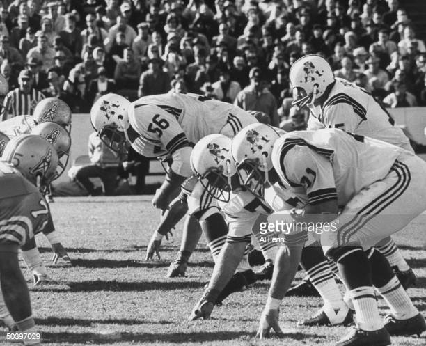 Action during a football game between the Houston Oilers and the Boston Patriots