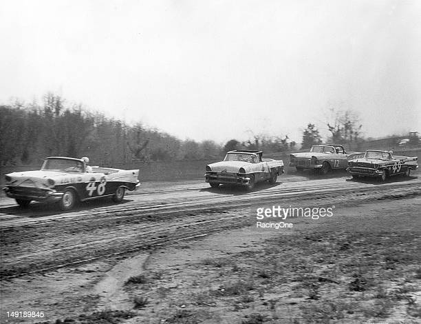 "Action during a NASCAR Convertible Division race has the Chevrolet of Lewis ""Possum"" Jones leading the Mercury of Bobby Myers Joe Weatherly's Ford..."