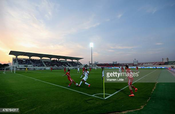 Action during the Asian Cup Qualification match between China and Iraq at the AlSharjah Stadium on March 5 2014 in Sharjah United Arab Emirates