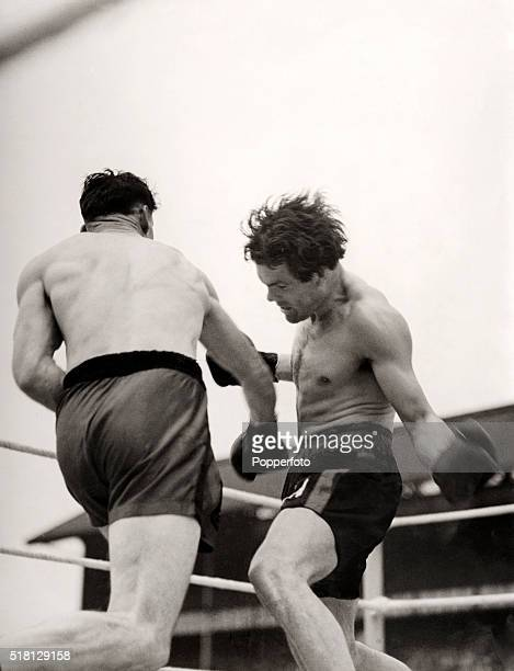 Action during the British and Empire light heavyweight title boxing match between Pilot Officer Len Harvey and Sergeant Freddie Mills at White Hart...