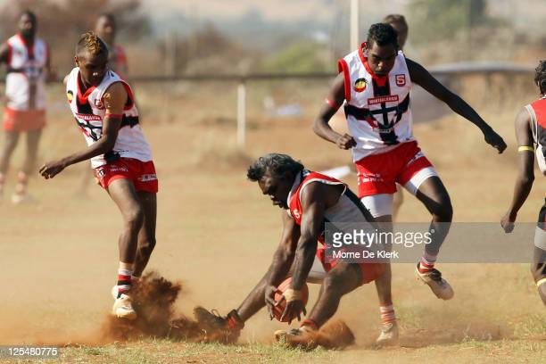 Action during the Far North West Sports League football grand final between Amata in black and Wintjalangu in white on September 17, 2011 in...