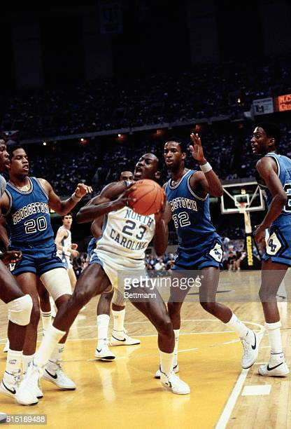 Action during the NCAA Championship as Fred Brown of Georgetown defends against North Carolina's Michael Jordan