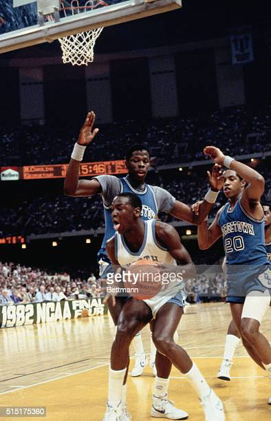 Action during the NCAA Championship as Patrick Ewing of Georgetown defends against North Carolina's Michael Jordan
