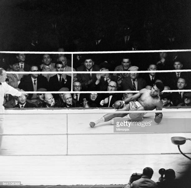 Action during the non-title heavyweight fight between American Cassius Clay and British fighter Henry Cooper at Wembley Stadium, London, Thirty five...