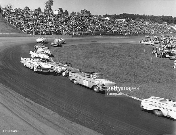 Action during the Old Dominion 500 at Martinsville Speedway with Emanuel Zervakis in a Chevrolet leading the Fords of Marvin Panch and Bill Morton
