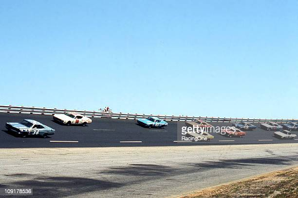 Action during the Rebel 400 NASCAR Cup race at Darlington Raceway. LeeRoy Yarbrough , Richard Petty and Bobby Allison take the high line to put a lap...