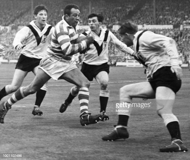 Action during the Rugby League clash between Wigan and Hull during the Challenge Cup Final at Wembley Stadium. Picture shows: Three men team up to...