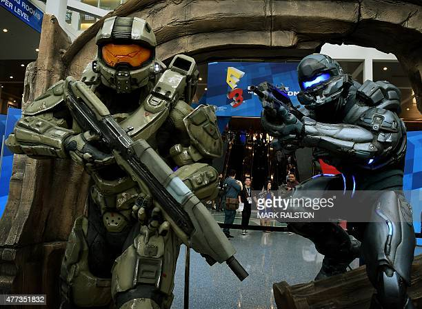 Action figures from the game 'Halo' welcome visitors on the opening day of the Electronic Entertainment Expo known as E3 at the Convention Center in...
