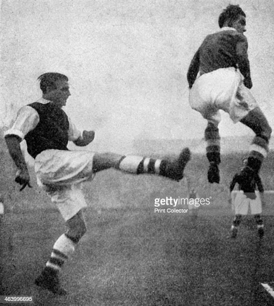 Action from an Arsenal v Chelsea football match c1936c1944 Arsenal's Eddie Hapgood and Chelsea's Peter Buchanan in a strange pose A print from...
