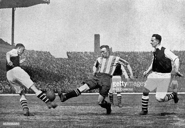Action from an Arsenal v Sheffield United football match, c1927-1937. A split second interception, and Ball is beaten to the ball by Arsenal's Eddie...