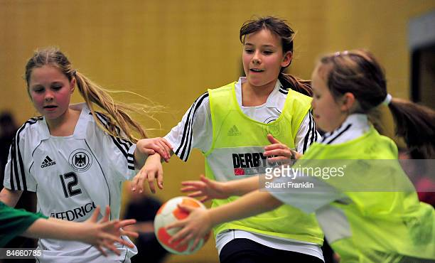Action from handball game involving girls from local teams and Olympic athlets at an event where children meet Olympic competitors at the Hamburg...