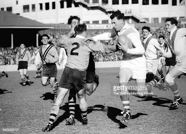 Action from the 1956 rugby league match between the St George Dragons and Balmain Tigers 25 August 1956 SMH Picture by STAFF