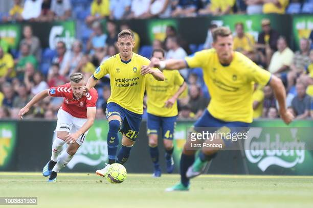 The fans of Vejle Boldklub cheer during the Danish Superliga match between Brondby IF and Vejle Boldklub at Brondby Stadion on July 22 2018 in...