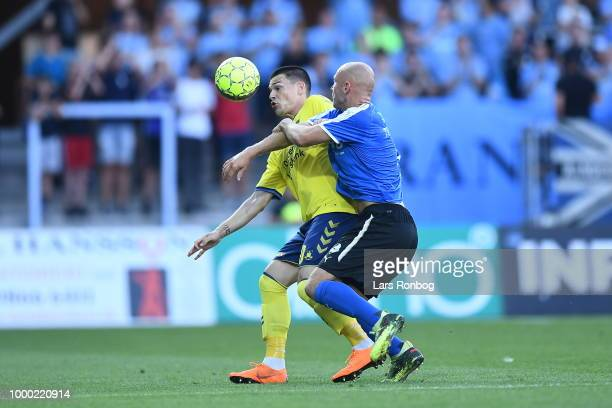 Simon Tibbling of Brondby IF and Frederik Lauenborg of Randers FC compete for the ball during the Danish Superliga match between Randers FC and...