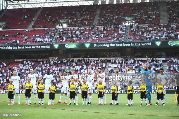General view of the two teams walking on to the pitch with the the FC Copenhagen mascots and young children prior to the UEFA Europa League Qual...