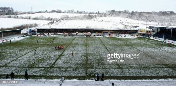Action is pictured on a snow covered pitch during the Heineken Cup match between London Wasps and Newport Gwent Dragons at Adam Park on December 19...