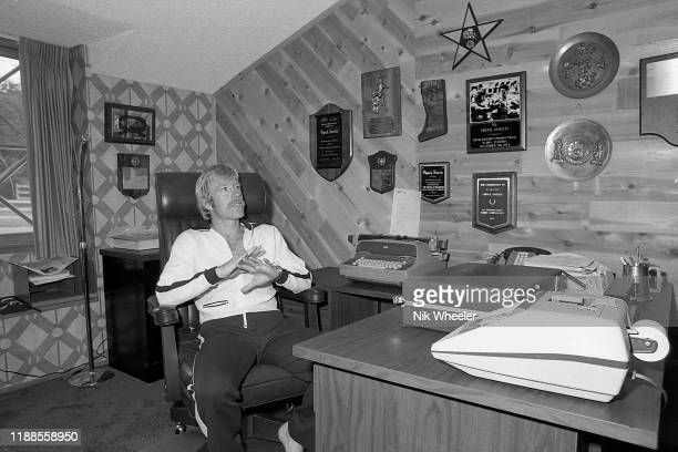 Action movie hero and screenwriter Chuck Norris sits in chair at his desk in his office at home in Palos Verdes in Southern California USA circa 1978