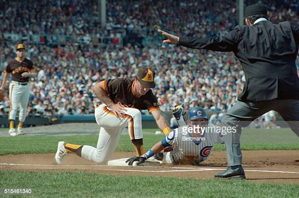 Action of Chicago Cubs vs Padres National League Playoffs Bob Dernier Chicago Cubs outfielder is safe at first on pickoff attempt by Thurmond Padres...