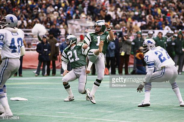 Action of Tony Franklin, Philadelphia Eagles, kicking field goal and watching flight of ball in game with Detroit Lions.